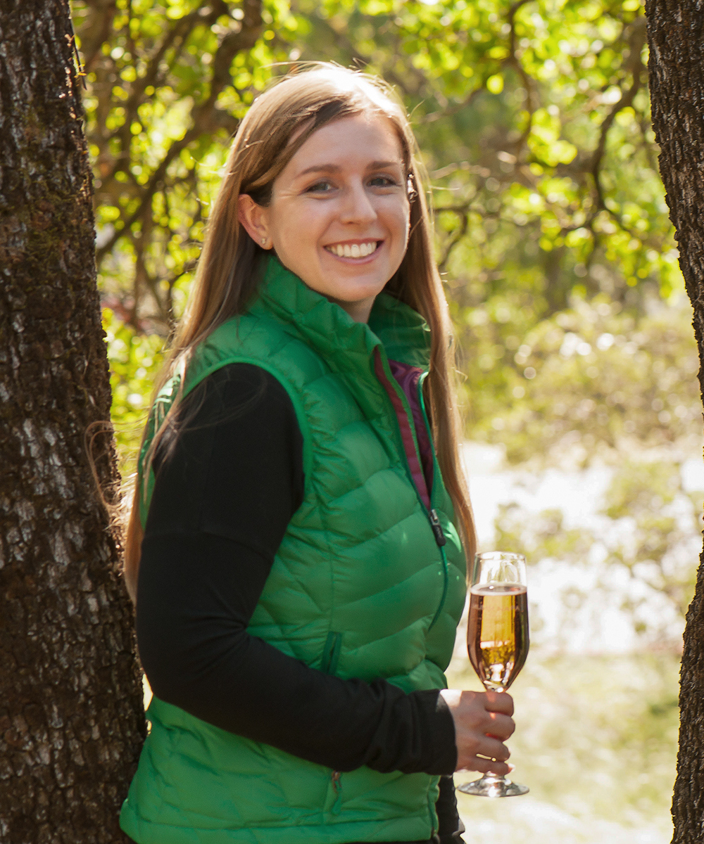Assistant Winemaker Tami Lotz holding a full wine glass